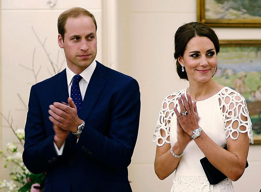 Britain`s Prince William and his wife Kate, the Duchess of Cambridge, listen to an address by the Australian Governor General Peter Cosgrove at a reception at Government House in Canberra, Australia.
