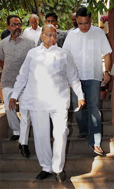 NCP, Chief Sharad Pawar along with his son-in-law Sadanand Sule (R) arrives to cast his vote for the Lok Sabha elections 2014 in Mumbai.