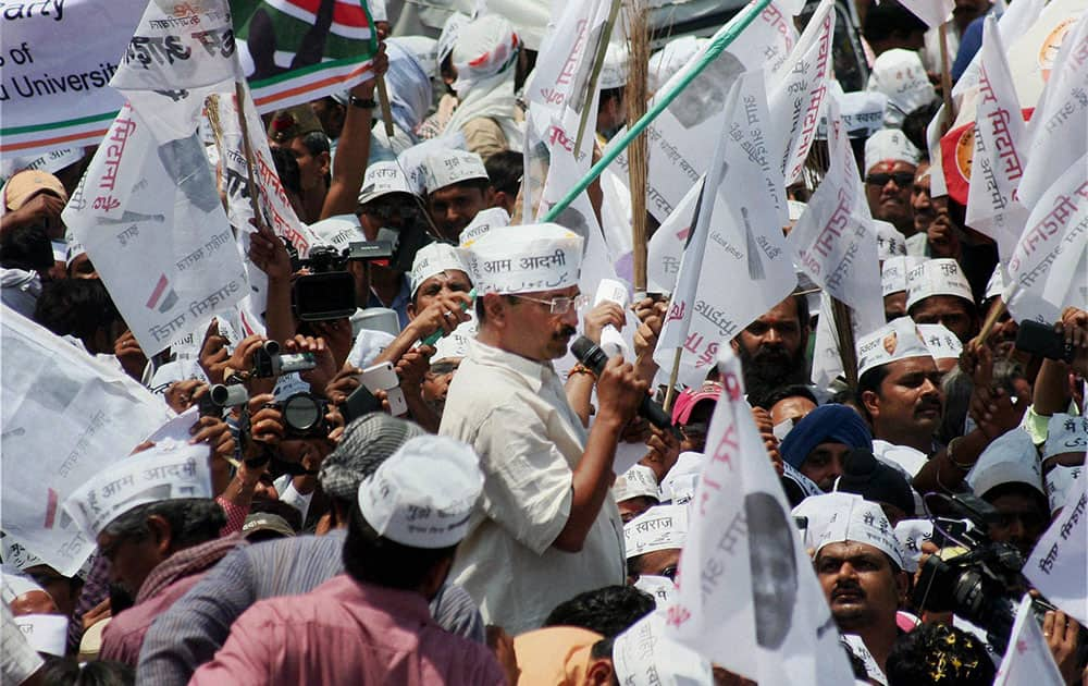 AAP convener Arvind Kejariwal addressing to supporters at a roadshow before filing his nomination papers in Varansi.