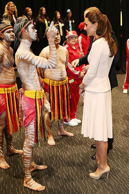 Britain`s Kate, the Duchess of Cambridge, right, speaks to performers during a visit to the youth community center, The Northern Sound System, in the suburb of Elizabeth, in Adelaide, Australia.
