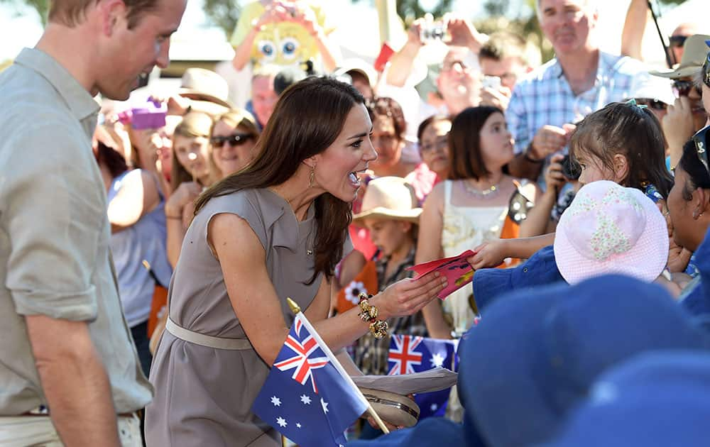 Britain`s Prince William and Kate Duchess of Cambridge speak to locals during a visit to the National Indigenous Training Academy at Uluru, Australia.