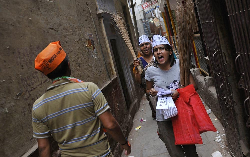 Supporters of Aam Aadmi Party and BJP come face-to-face while campaigning in Mumbai.