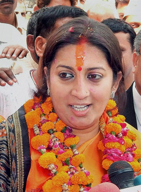 BJP candidate Smriti Irani talks to media at a roadshow before filing her nomination papers for Lok Sabha polls in Amethi.