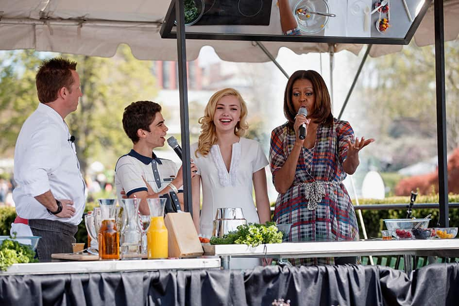 First lady Michelle Obama hosts a healthful recipes demonstration with, chef Marc Murphy, and Cameron Boyce and Peyton List from the Disney Channel show `Jessie,` during the annual White House Easter Egg Roll.