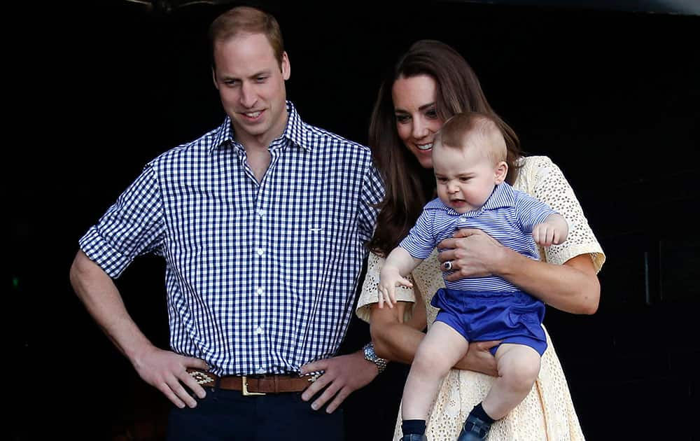 Britain`s Kate, the Duchess of Cambridge, and her husband Prince William watch as their son Prince George looks at an Australian animal called a Bilby, which has been named after the young prince, during a visit to Sydney`s Taronga Zoo, Australia.
