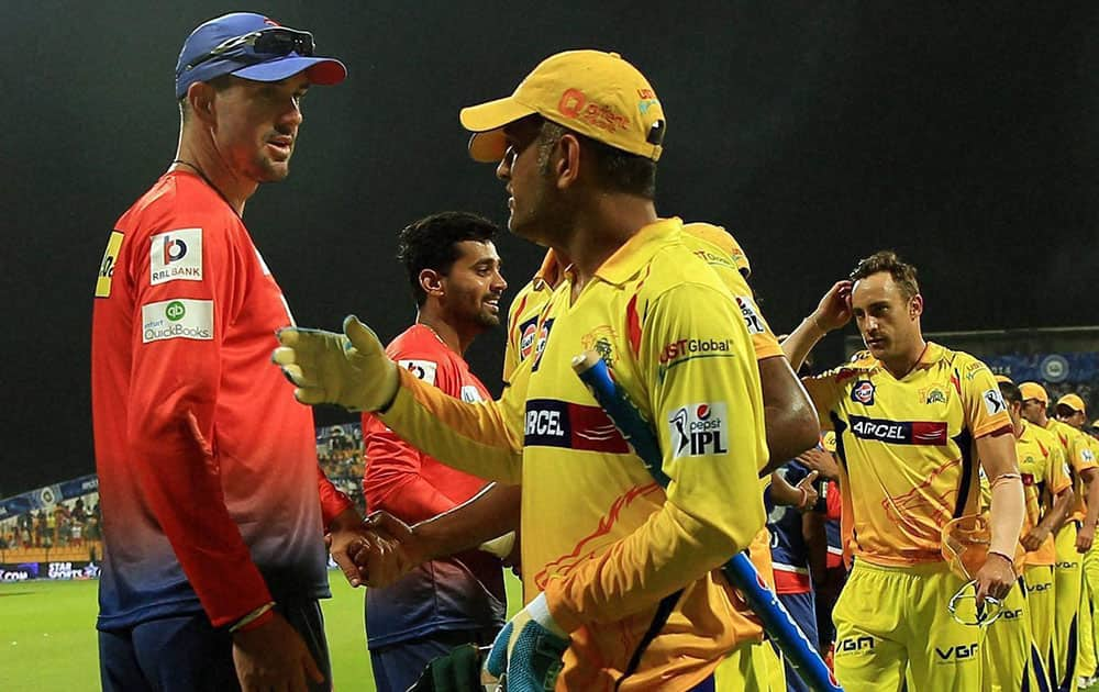 MS Dhoni captain of The Chennai Superkings and Kevin Peter Pietersen of the Delhi Daredevils shakes hand after the IPL-7 match at the Zayed Cricket Stadium in Sharjah, United Arab Emirates.