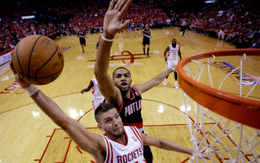 Houston Rockets` Chandler Parsons (25) goes up for a shot as Portland Trail Blazers` Nicolas Batum defends during the first half in Game 1 of an opening-round NBA basketball playoff series,in Houston.