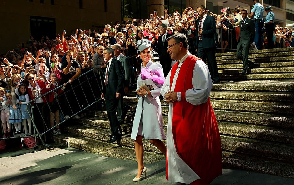 Britain`s Kate, the Duchess of Cambridge, center, walks with The Most Reverend Glenn Davies, Archbishop of Sydney, right, following an Easter Sunday service at St. Andrews Cathedral in Sydney.