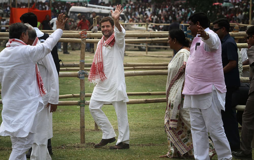 Rahul Gandhi waves to the crowd during an election rally in Nagaon, in the northeastern Indian state of Assam.