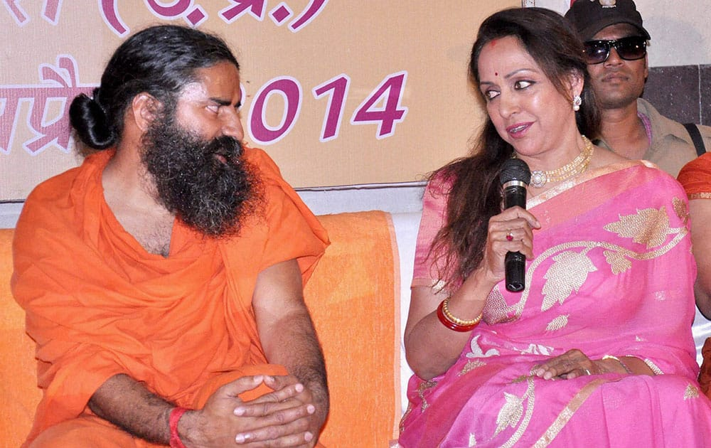 Actress & BJP candidate Hema Malini with Baba Ramdev addressing in press conference in vrindavan.