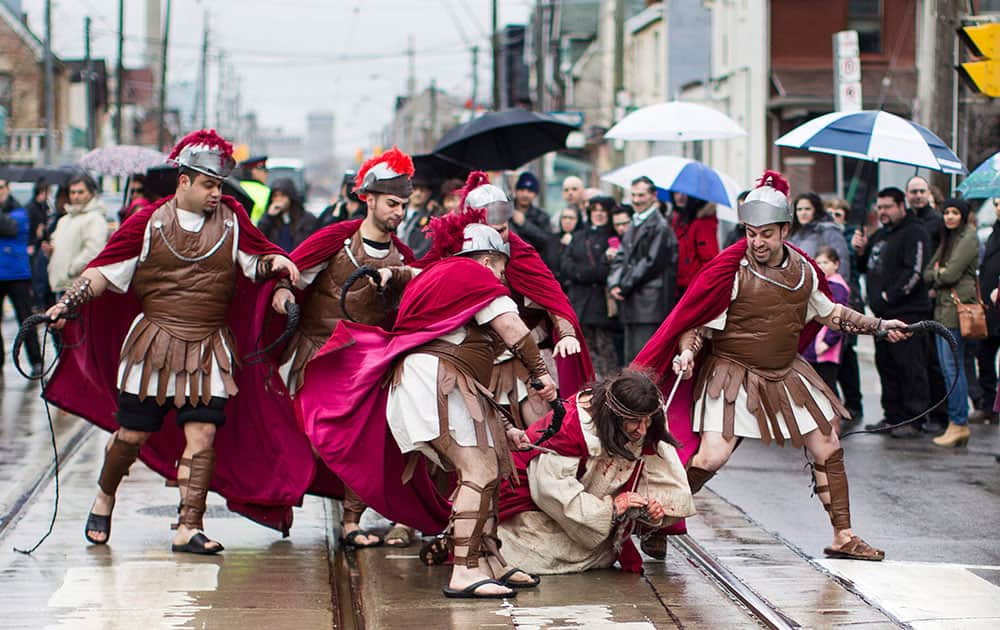 Fabio Gesufatto portrays Jesus as he is set upon by Roman Guards during the Good Friday procession in Toronto`s Little Italy neighbourhood.