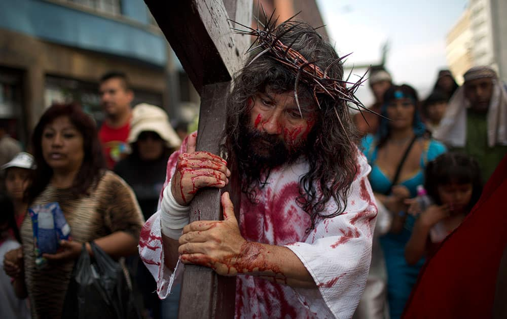 Jesus Christ, portrayed by Mario Valencia, better known as `Cristo Cholo,` reenacts the Passion of Christ in Lima, Peru.