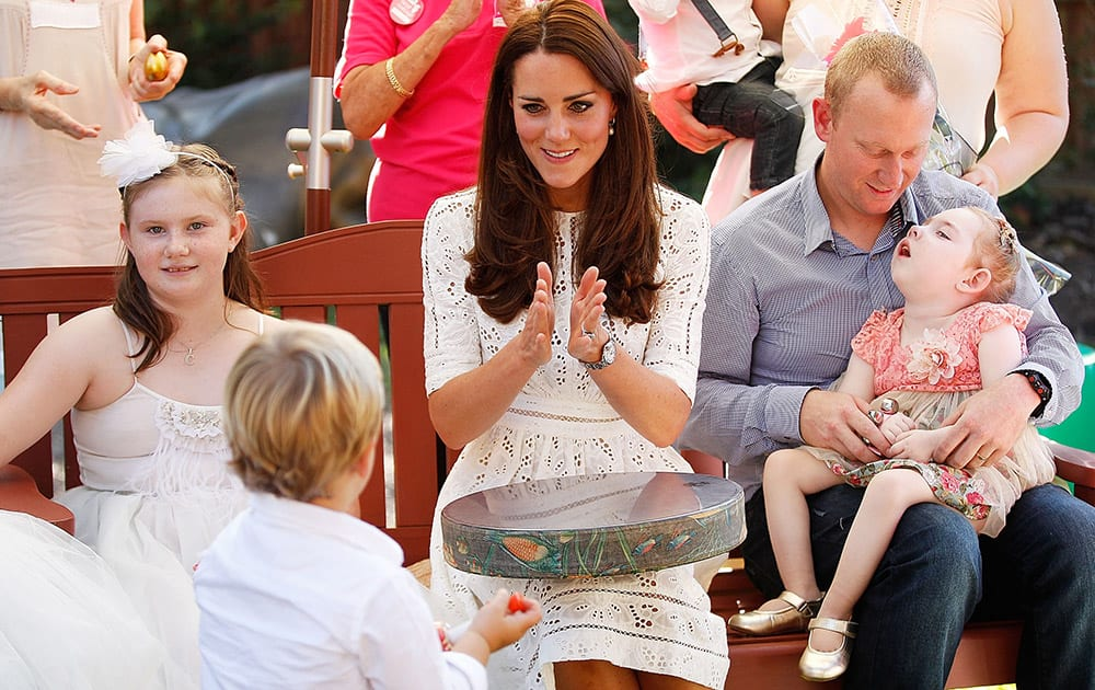 Britain`s Kate, the Duchess of Cambridge sings with patients of Bear Cottage, a children`s hospice, in Sydney, Australia.