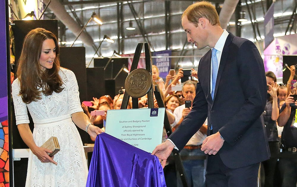 Britain`s Prince William, Kate, Duchess of Cambridge, unveil a plaque to mark the official opening of a new arts and craft pavilion during a visit to the Royal Easter Show in Sydney, Australia.