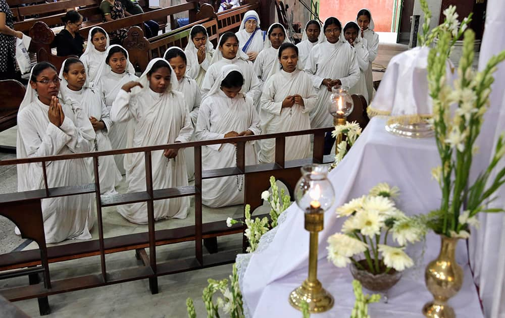 Catholic nuns of Missionaries of Charity, the order founded by Mother Teresa, pray during Good Friday Mass at a church in Kolkata.