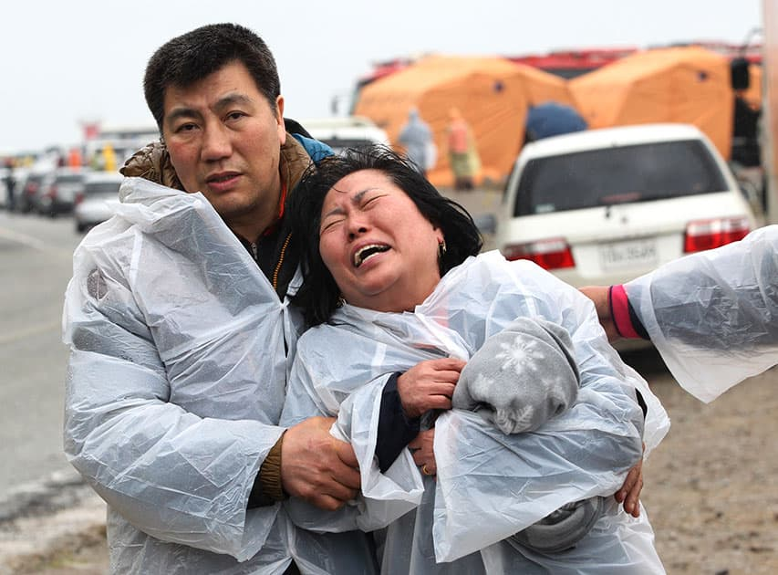 A relative of a passenger aboard a sunken ferry weeps at a port in Jindo, South Korea.