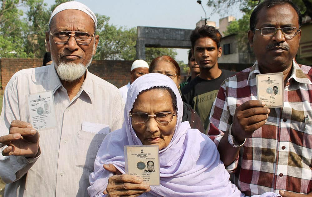 Members of a Muslim family arrive to cast their votes for Lok Sabha elections in Jamshedpur.