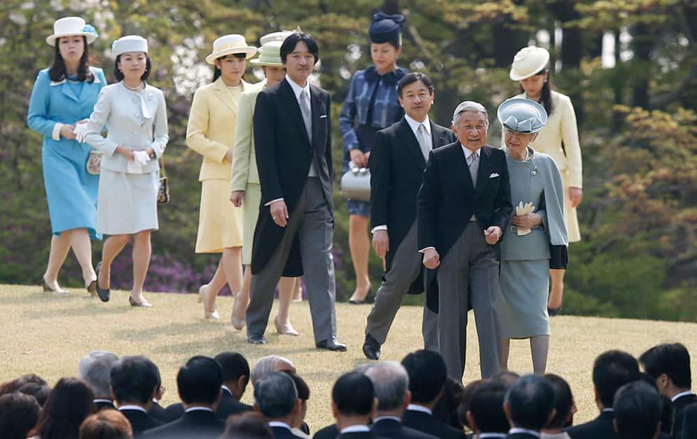 Japan`s Emperor Akihito and Empress Michiko arrive with Crown Prince Naruhito, Prince Akishino, his wife, Princess Kiko and other royal members at a spring garden party at the Akasaka Imperial Garden in Tokyo.