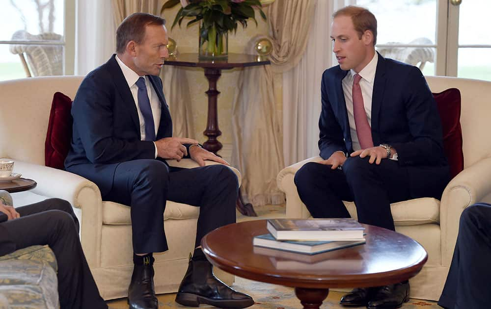 Britain`s Prince William meets with Australian Prime Minister Tony Abbott at Admiralty House in Sydney.