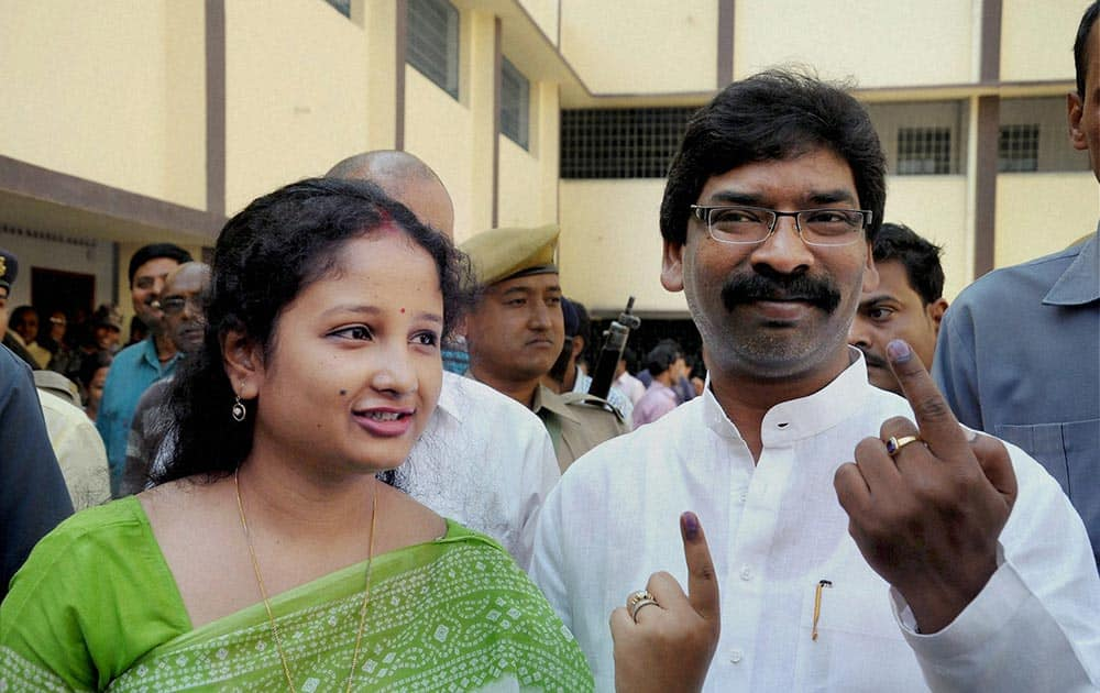 Jharkhand CM Hemant Soren and his wife show ink marked finger after casting their vote for Lok Sabha election in Ranchi.