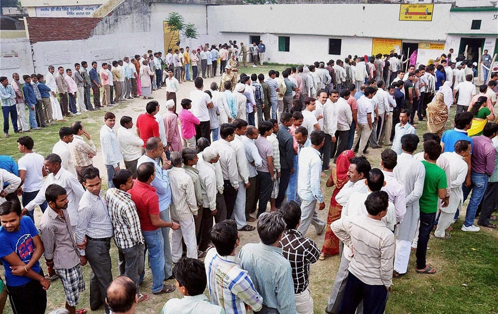 Voters stand in queue to cast their vote for Lok Sabha elections in Moradabad, Uttar Pradesh.