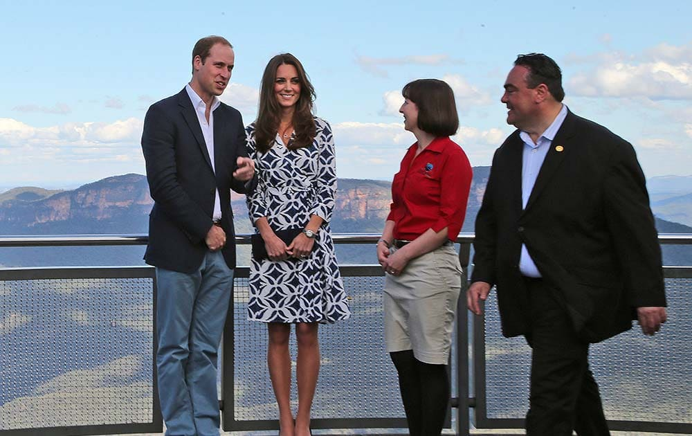 Britain`s Prince William, left, and his wife Kate, the Duchess of Cambridge, second left, stand with Randall Walker, right, chief executive officer of Blue Mountains Lithgow and Oberon Tourism and Anthea Hammon, joint managing director of Scenic World at Echo Point Lookout in Katoomba, Australia.