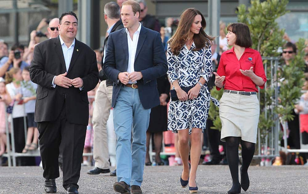 Britain`s Prince William, center left, and his wife Kate, the Duchess of Cambridge , center right, walk with Randall Walker, left, chief executive officer of Blue Mountains Lithgow and Oberon Tourism and Anthea Hammon, joint managing director of Scenic World the Echo Point Lookout at in Katoomba, Australia.