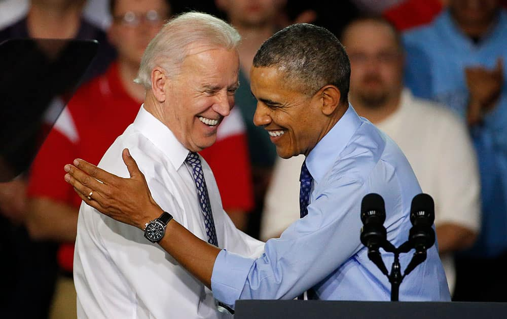 President Barack Obama is introduced by Vice President Joe Biden as he arrives at the Community College of Allegheny County West Hills Center in Oakdale, Pa.