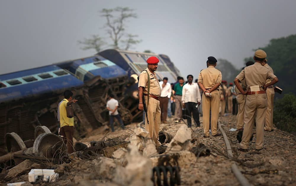 Policemen stand by a train that derailed near Jagiroad Railway Station, about 90 kilometers (56 miles) east of Guwahati.