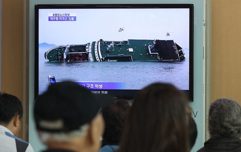 People watch a TV news program showing a sinking passenger ship, at Seoul Railway Station in Seoul, South Korea. The South Korean passenger ship carrying more than 470 people, including many high school students, is sinking off the country`s southern coast Wednesday after sending a distress call, officials said.