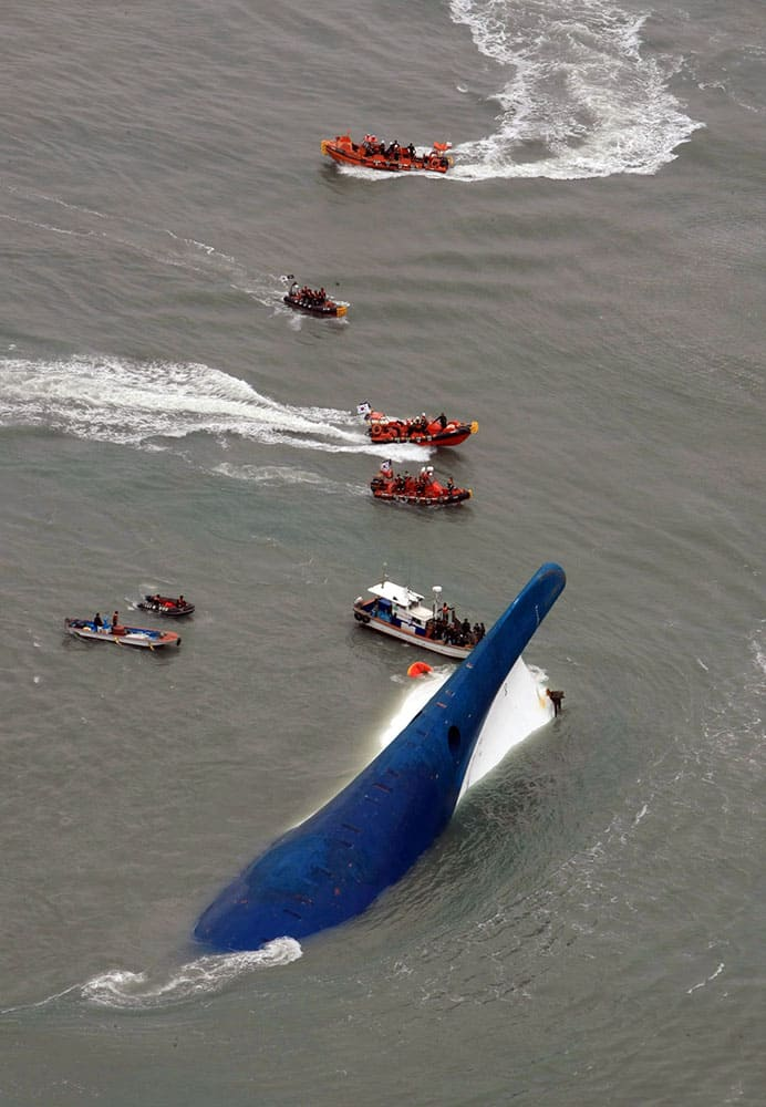 South Korean rescue team boats and fishing boats try to rescue passengers of a ferry sinking off South Korea`s southern coast, in the water off the southern coast near Jindo, south of Seoul.