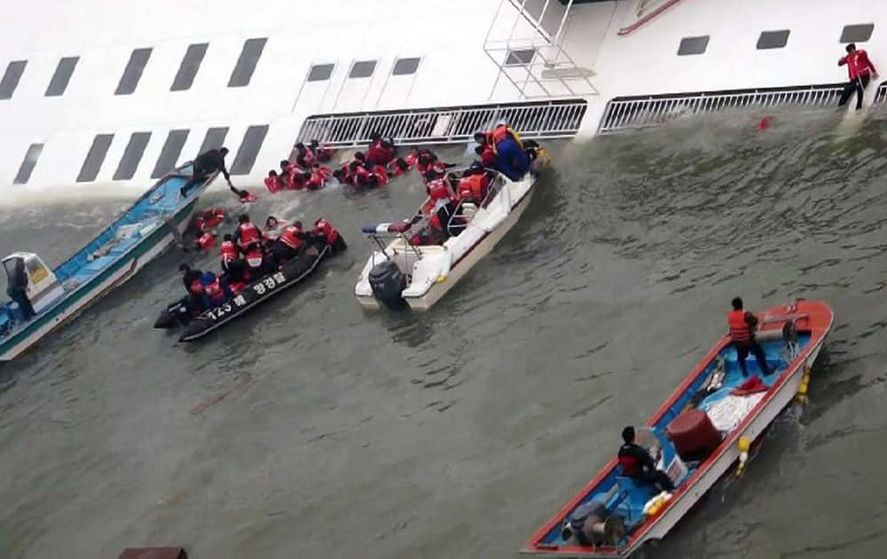 Passengers from a ferry sinking off South Korea`s southern coast, are rescued by South Korean Coast guard in the water off the southern coast near Jindo, south of Seoul.