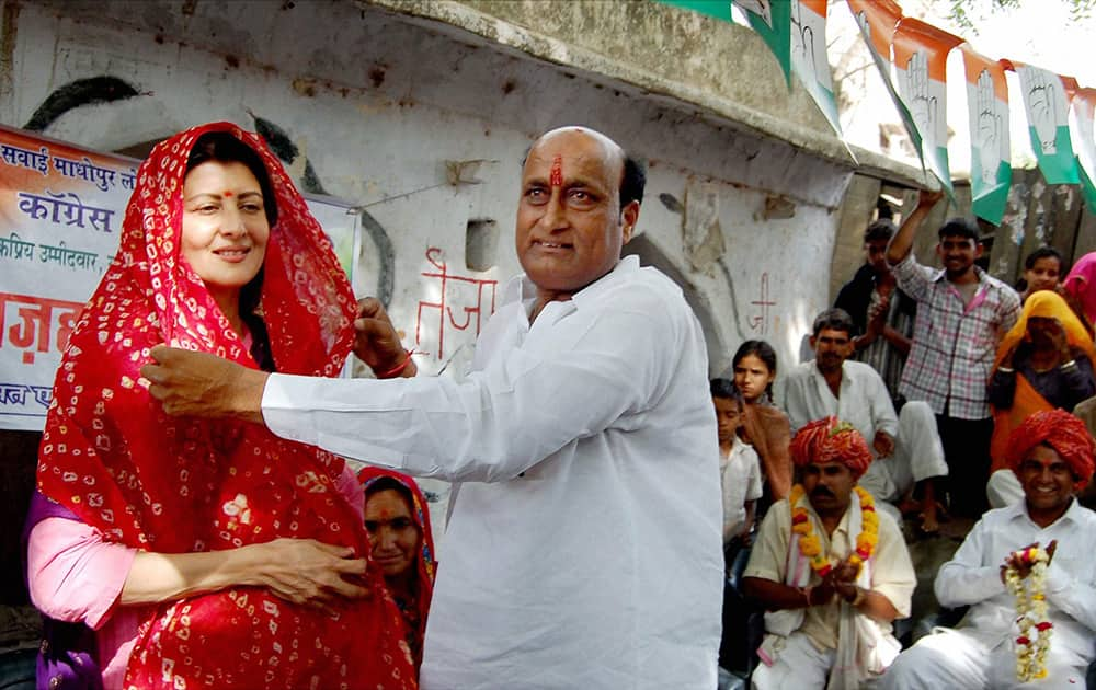 Sangeeta Bijlani is offered a `chunri` by a supporter during an election campaign in supoort of Congress candidate Mohammad Azharuddin in Tonk.