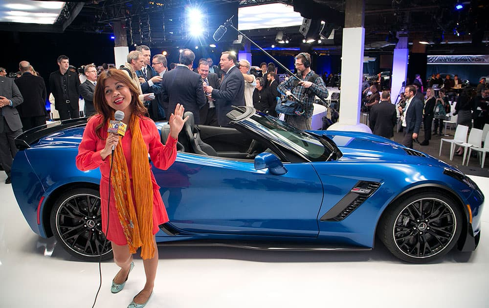 Members of the media surround the Chevrolet 2015 Corvette Z06 convertible at the New York International Auto Show, in New York.