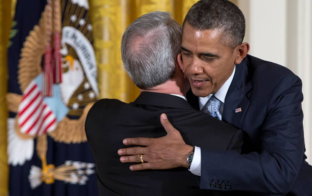 President Barack Obama embraces Dr. Joel C. Hunter, senior pastor of Northland, A Church Distributed, in Longwood, Fla., during the Easter Prayer Breakfast, in the East Room of the White House in Washington.