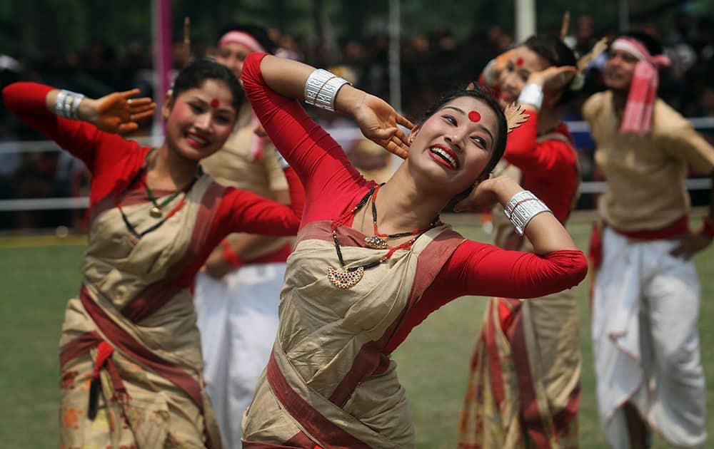 Artists from Assam state perform Bihu, a folk dance, during celebrations to mark Rongali Bihu festival in Guwahati.