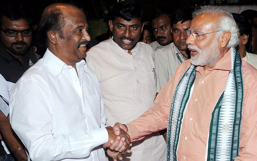 BJP Prime Ministerial candidate Narendra Modi with superstar Rajinikanth at his residence in Chennai.