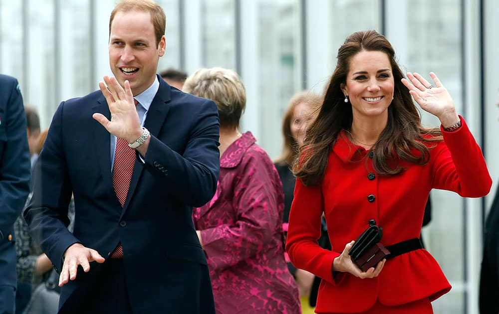 Britain`s Prince William, left, and his wife Kate, the Duchess of Cambridge, wave after their tour of the new visitors center at the Christchurch botanical gardens  in Christchurch, New Zealand.