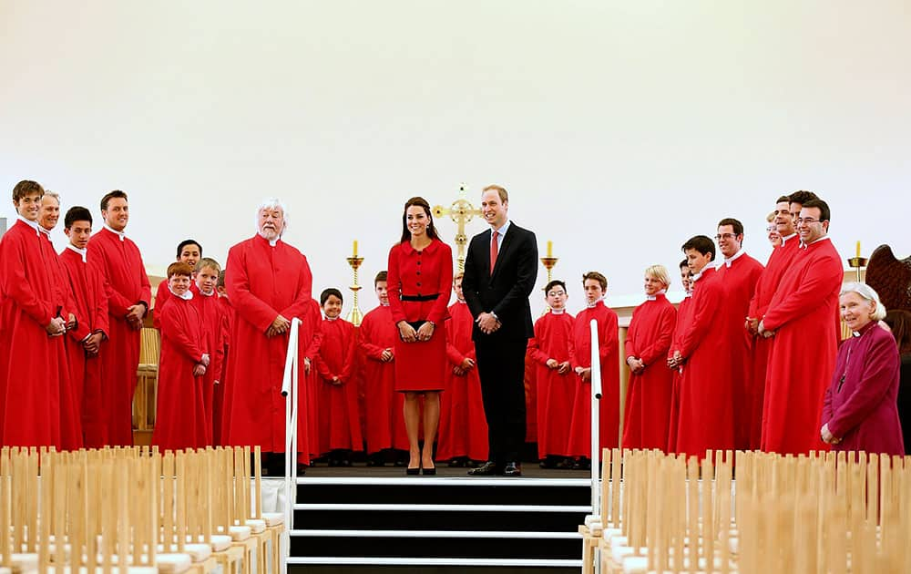 Britain`s Prince William, center right, and his wife Kate, the Duchess of Cambridge, center left, pose with members of the Christchurch Cathedral choir during visit to the Transitional Cathedral in Christchurch, New Zealand.