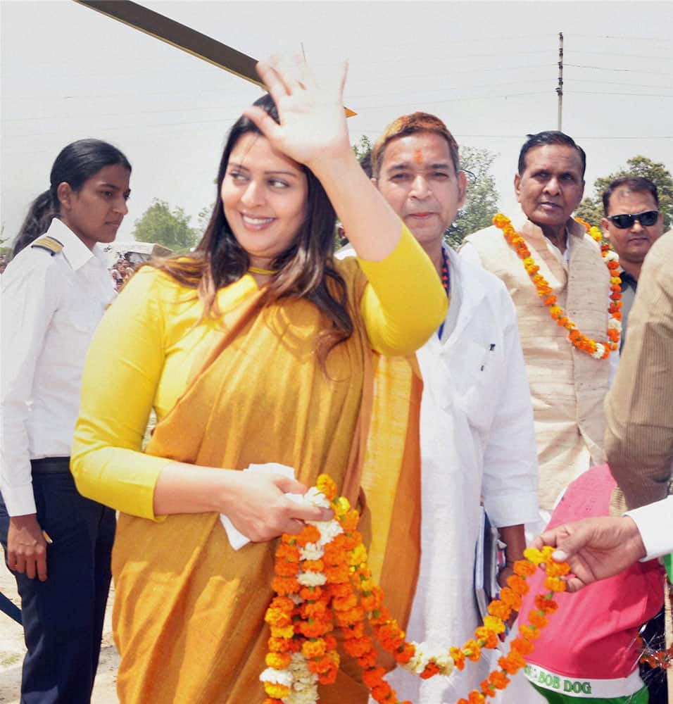 ACTRESS AND CONGRESS CANDIDATE FROM MEERUT, NAGMA WAVES TO HER SUPPORTERS DURING AN ELECTION CAMPAIGN FOR CONGRESS CANDIDATE FROM PILIBHIT SEAT, IN PILIBHIT.
