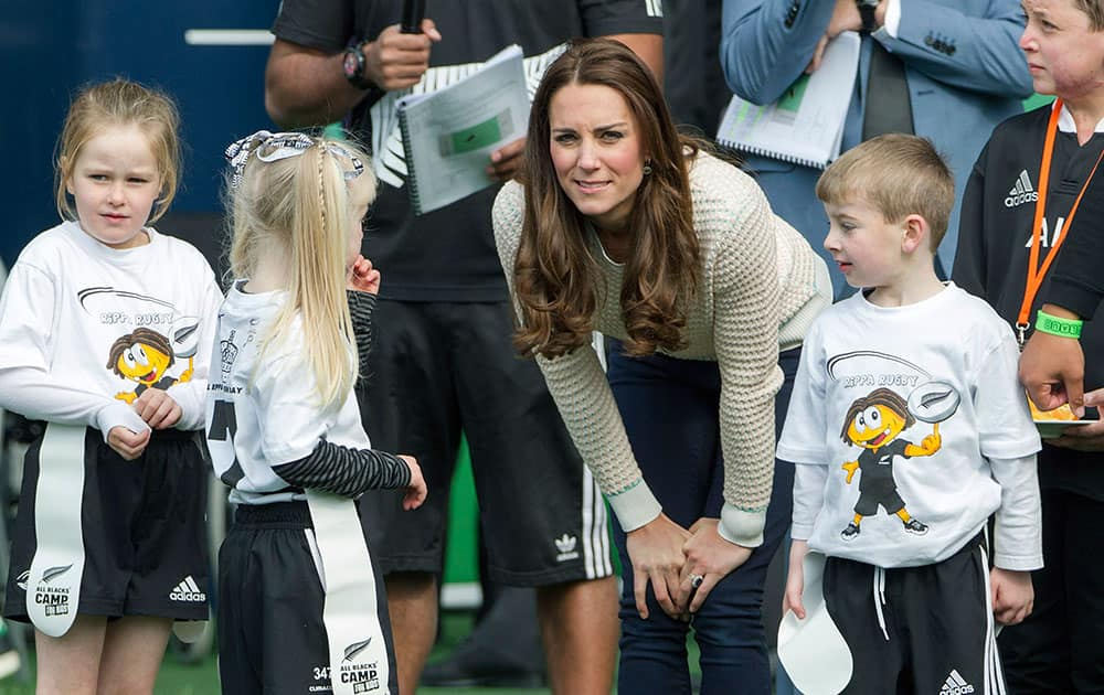 Britain`s Kate, the Duchess of Cambridge, speaks with Pirates team members as she and her husband Prince William visit a young players' rugby tournament, at Forsyth Barr Stadium, in Dunedin, New Zealand.
