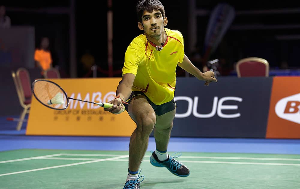 K. Srikanth of India returns a shot to Lee Chong Wei of Malaysia during their semifinal match at the Singapore Open Badminton championship in Singapore.