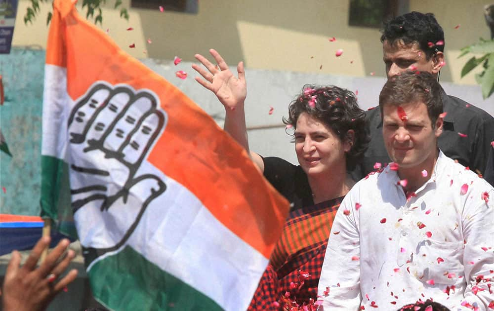 Congress Vice President Rahul Gandhi with his sister Priyanka Vadra waves to supporters on the way to file his nomination papers for Amethi parliamentary seat, in Amethi.
