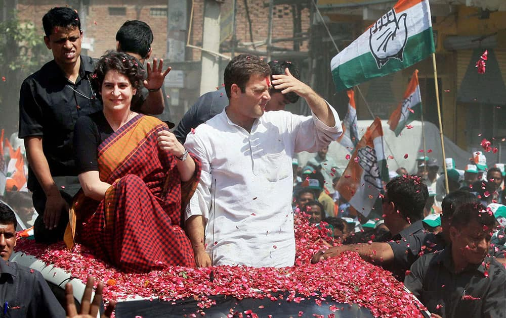 Congress Vice President Rahul Gandhi with his sister Priyanka Vadra on the way to file his nomination papers for Amethi parliamentary seat, in Amethi .