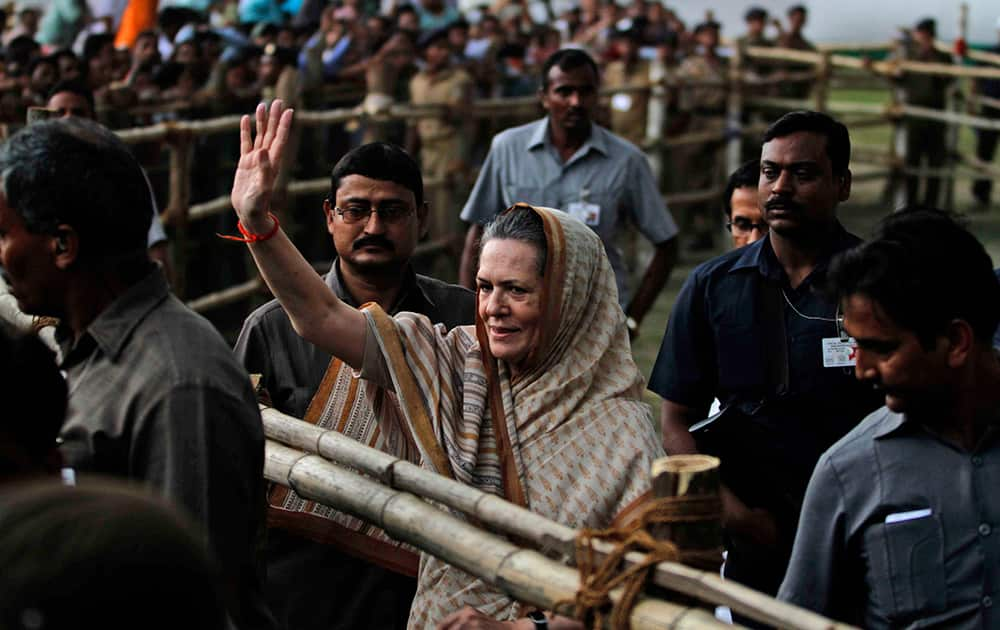 Sonia Gandhi waves to supporters during an election campaign rally in Balasore, Bhubaneswar.