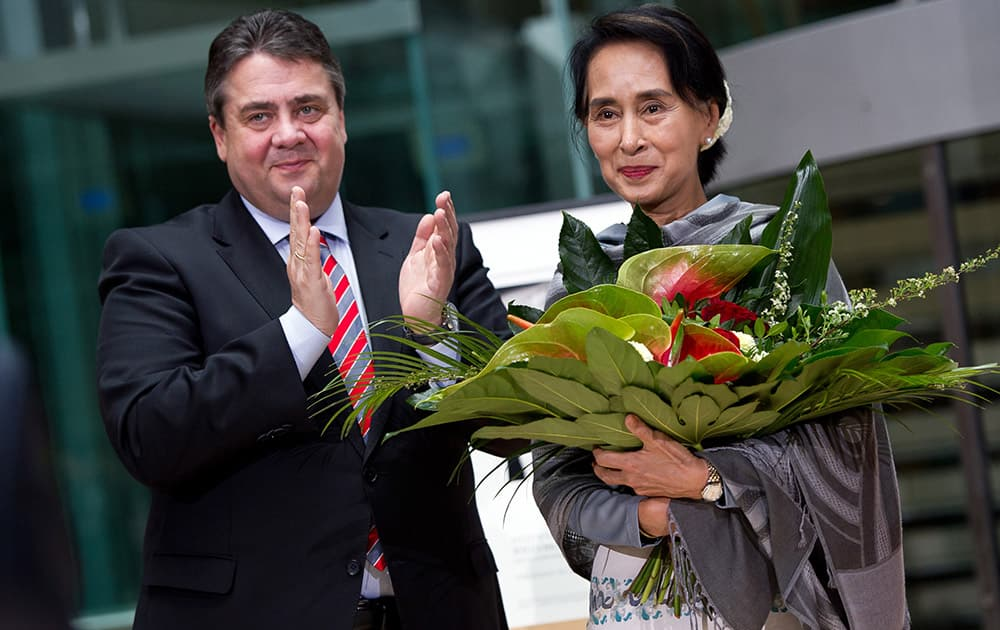 Myanmar Opposition Leader Aung San Suu Kyi, right, received flowers by German Economy and Energy Minister Sigmar Gabriel during Aung San Suu Kyi`s awarding ceremony with the Willy Brandt Award of the Social Democratic Party in Berlin.