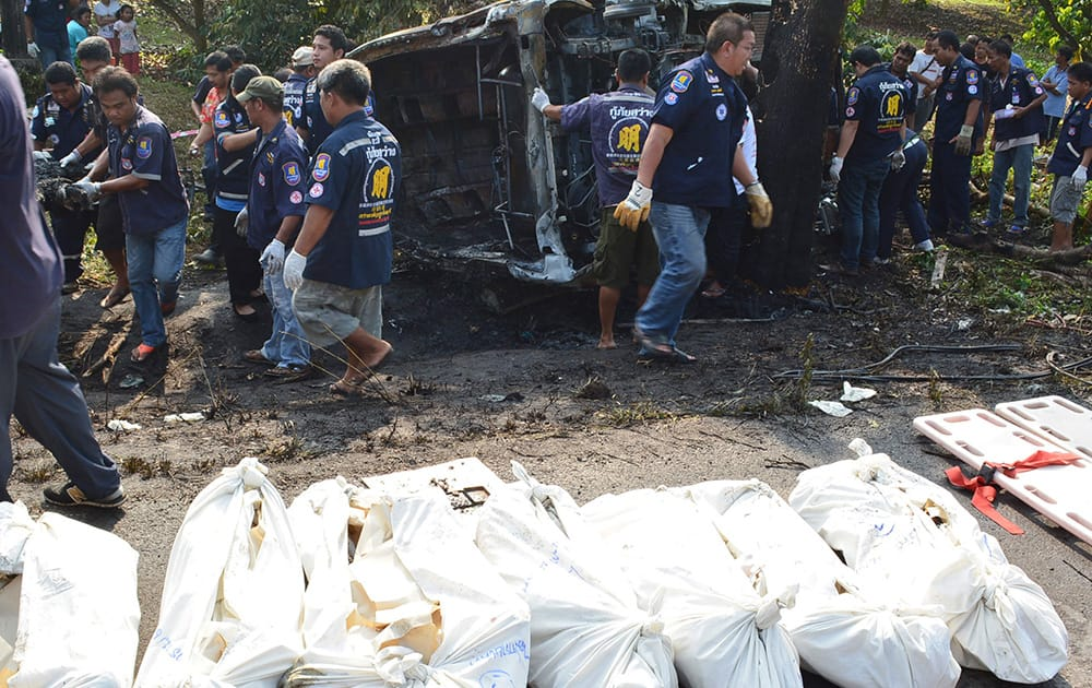 Bodies of passenger van victims are put on the roadside near the crash site by charity workers in Ta Mai district of Chanthaburi province, eastern Thailand. The accident killed at least 8 passengers and injured 13 others, Thai media reported.