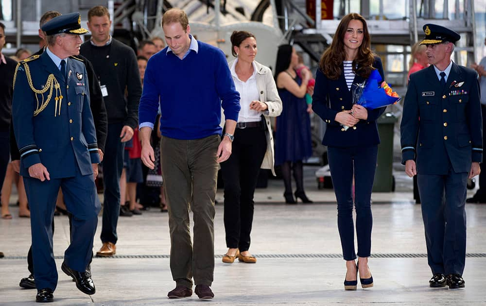 Britain`s Prince William, and his wife, Kate, the Duchess of Cambridge, arrive to meet with families at the Royal New Zealand Air Force base Whenuapai in Auckland.
