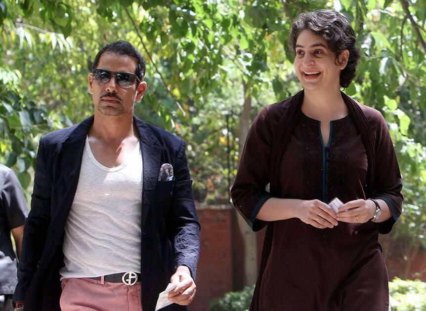 Priyanka Vadra with husband Robert Vadra arrives to cast their vote for Lok Sabha election in New Delhi.