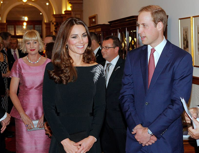 Britain`s Prince William and Kate, the Duchess of Cambridge, arrive for a state reception at Government House in Wellington, New Zealand